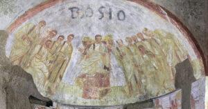 Malba Ježíše, který sedí na trůnu, obklopený apoštoly. Tuto malbu najdete v pohřebních komnatách katakomb Sv. Domitilla v Itálii.